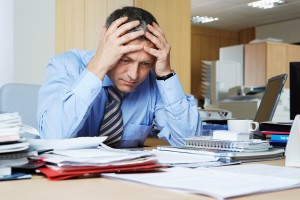stressed-man-with-head-in-hands